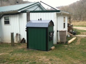 Outdoor wood furnace is  only set in place. There is much more that needs to be done.